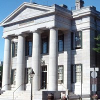 The Custom House, complete with white columns and sitting on the corner of William and N Second streets.