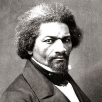 Black and white photo of middle-aged Frederick Douglass.