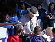 Junior Rangers on a scavenger hunt with a Park Ranger