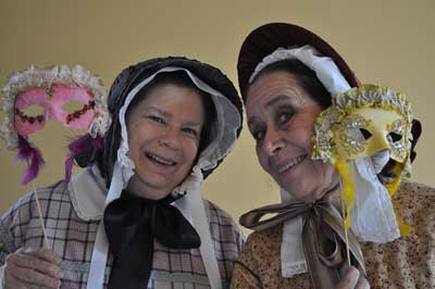 Our 1850s ladies in period dress show off their masks.