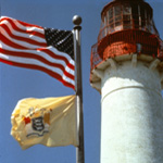 Cape May Point Lighthouse with US and NJ flags