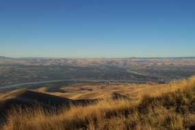 Confluence of the Snake and Clearwater Rivers from Highway 95 overlook. Lewiston, Idaho and Clarkston, Washington are on the left and right shores of the Snake River.