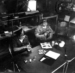 Viola Morris (left) and Ida Blackeagle (right) weaving bags at Watson's Store, shortly after Nez Perce NHP was founded.