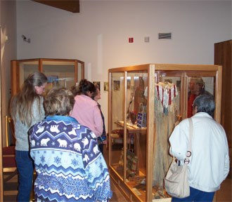 A group of visitors looking at museum exhibits.
