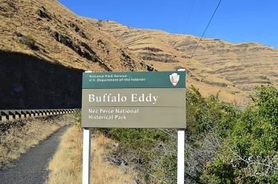 A green sign with the words 'Buffalo Eddy Nez Perce National Historical Park' on it.