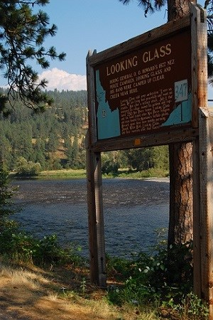 An interpretive sign with the words 'Looking Glass' with the river in the background.