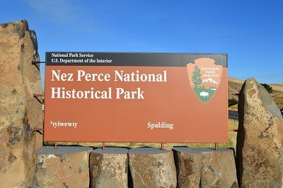 A brown colored sign that has 'Nez Perce National Historical Park' on it.