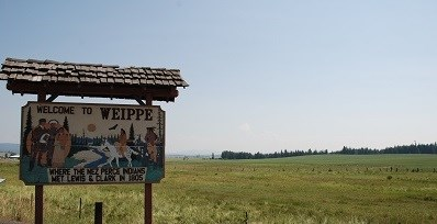 "Wooden sign with words that say ""Welcome to Weippe where the Nez Perce Indians met Lewis and Clark in 1805."""