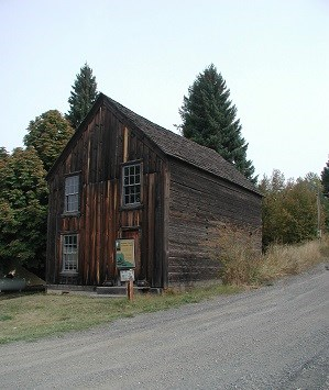 A two story building with wood paneling on the outside.