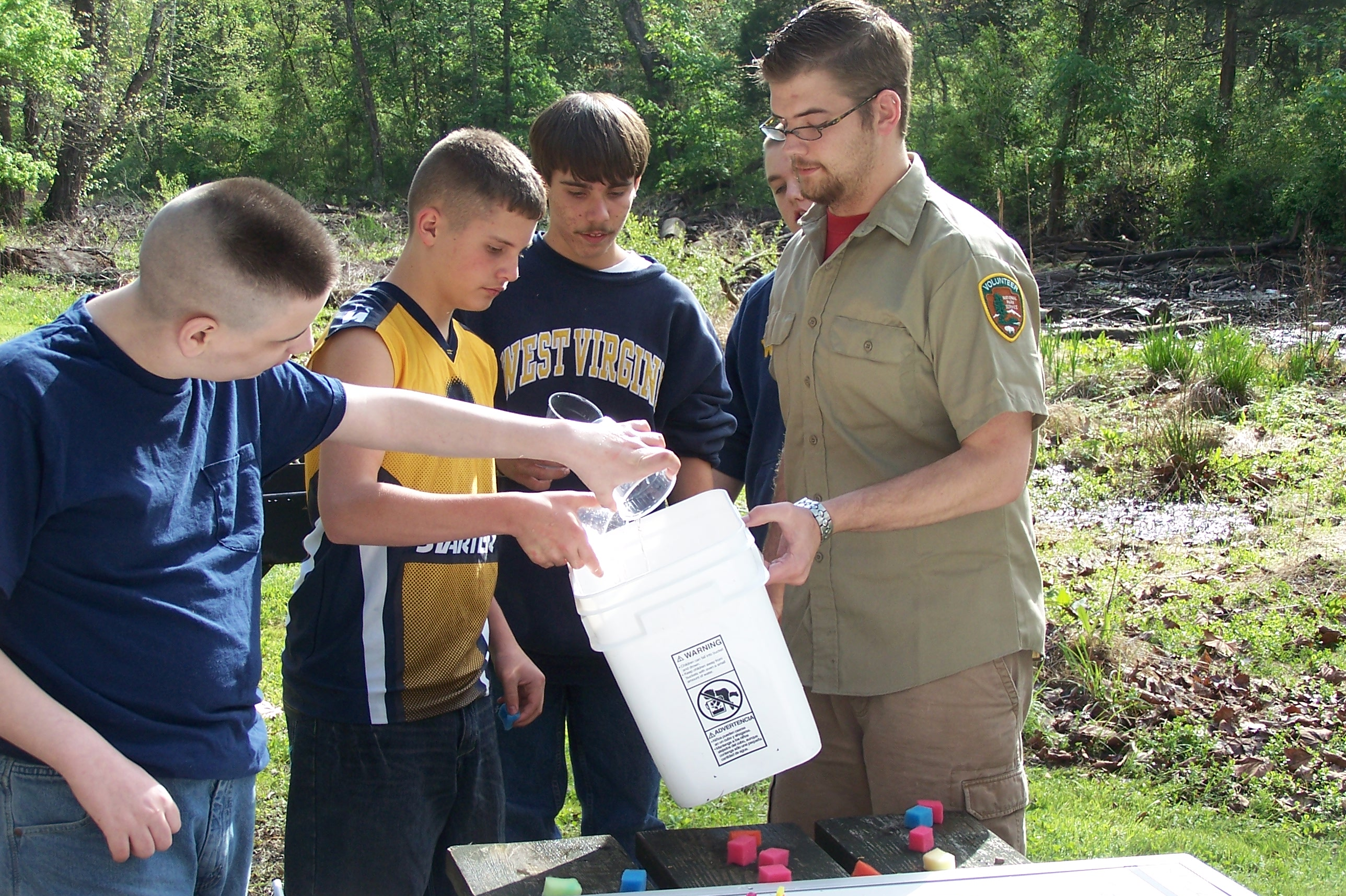 Volunteer assists with environmental education program
