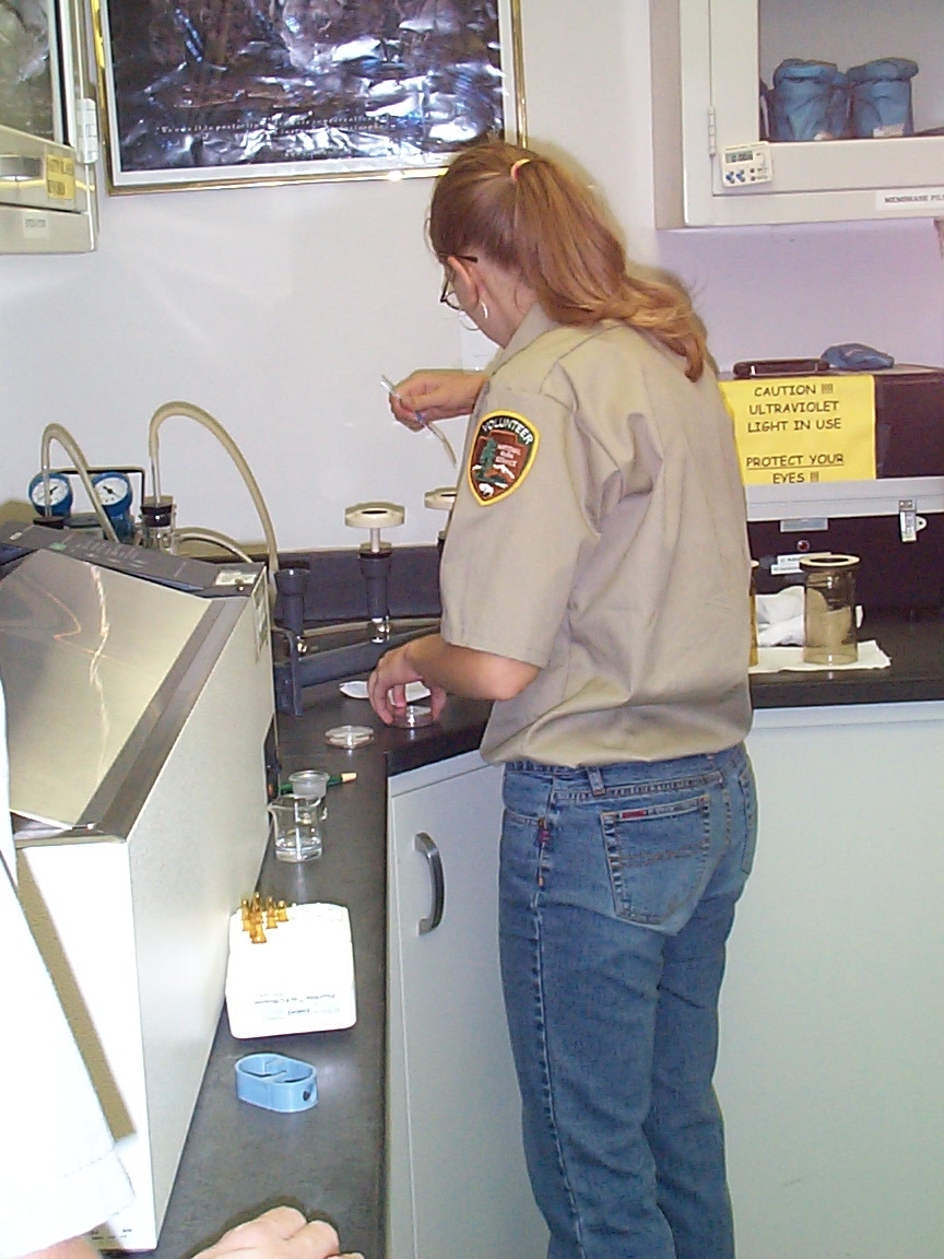 Volunteer assisting in resource management lab