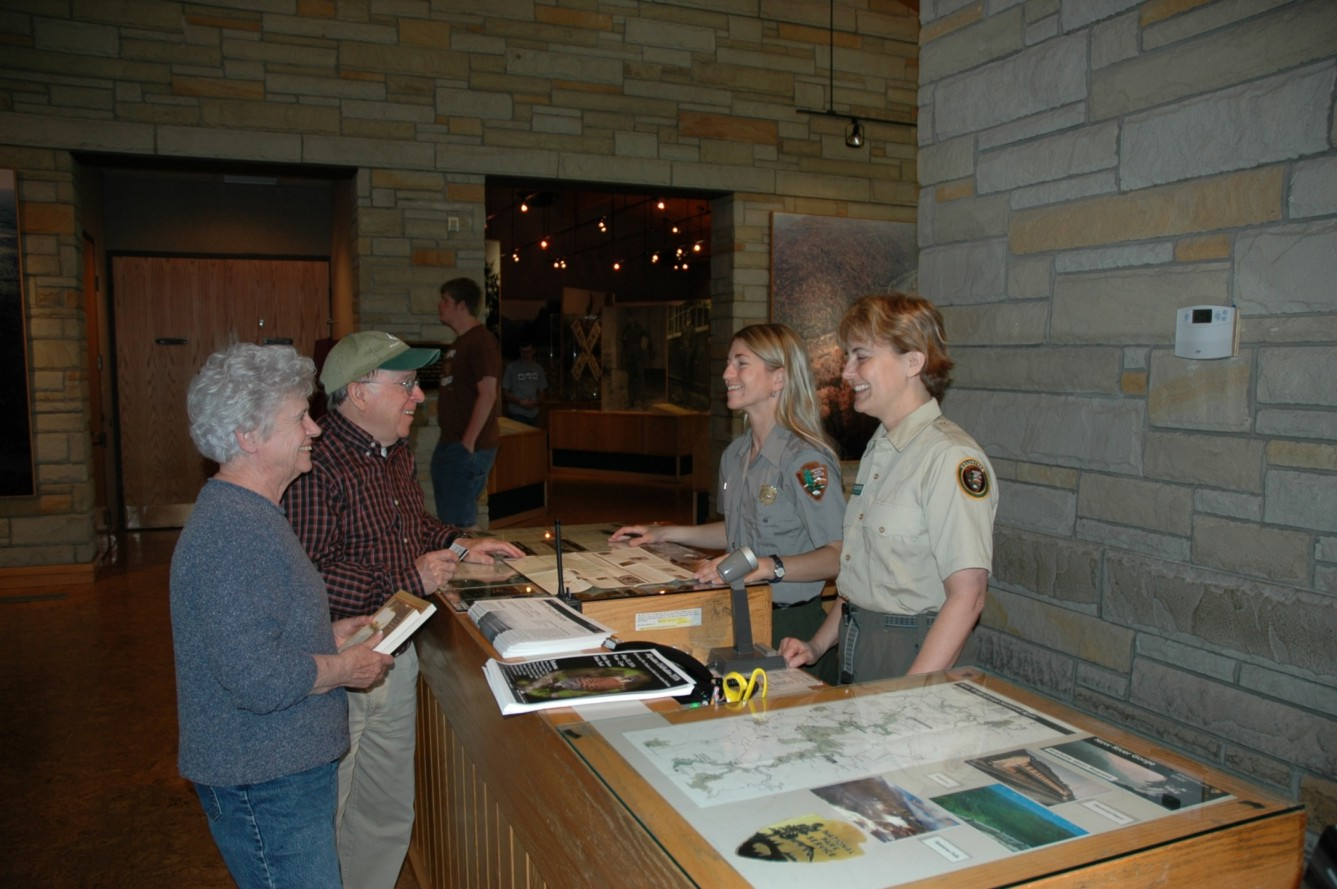Volunteer assisting at visitor center