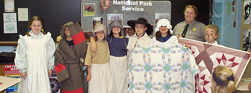 ranger and students dressed in period clothing
