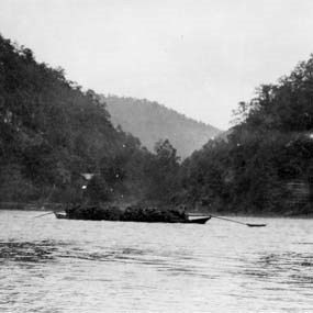 black and white historic photo of batteau on the New River