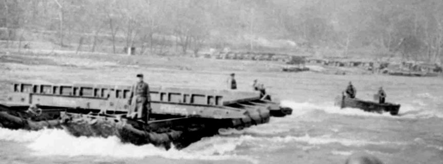 historic photo of Army soldiers training on the river