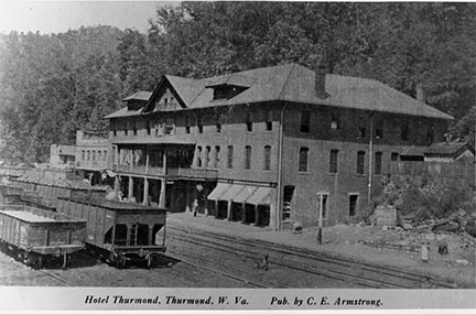 historic black and white photo of old hotel