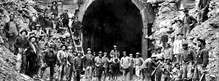 workers posing in front of a RR tunnel