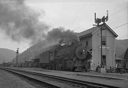 historic black and white photo of train at RR depot