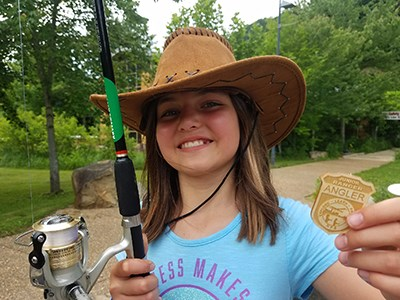 young girl with her Junior Ranger Angler badge