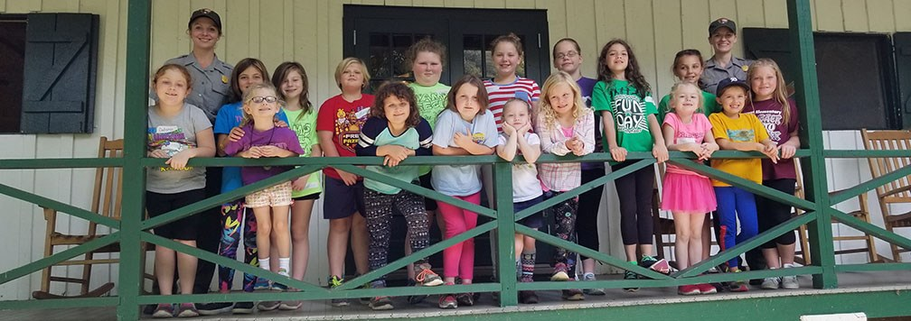 Girl Scouts on cabin porch