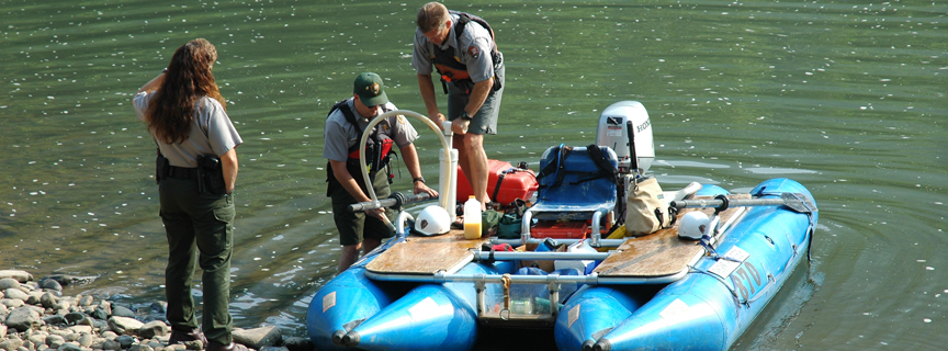 rangers preparing for a river patrol
