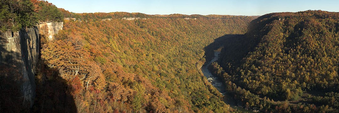 view of river and gorge with early fall colors