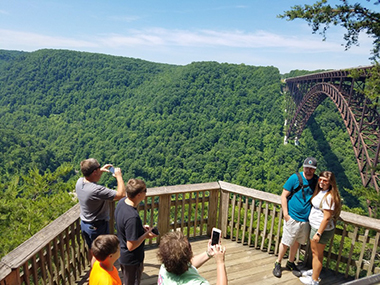 Viewing platforms on the boardwalk offer scenic views of the New River Gorge Bridge