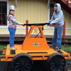 kids on a RR hand cart
