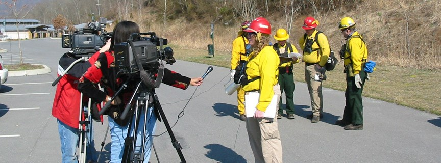 reporter conducting an interview with a firefighter