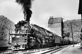 historic black and white photo of train engine