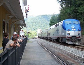 Visitors watching as AMTRAK train goes by at the Thurmond Depot