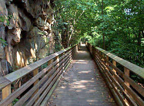 Wood decked railroad trestle along the trail