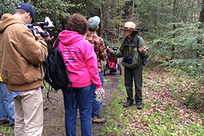 Ranger on trail with visitors