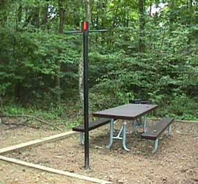picnic table and lantern pole at campsite
