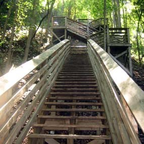 wooden steps descend to the bottom of the gorge