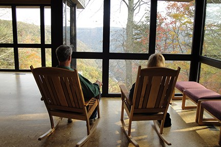visitors admiring the view from rocking chairs