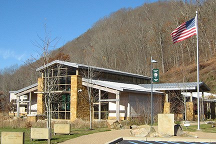visitor center exterior with mountain behind