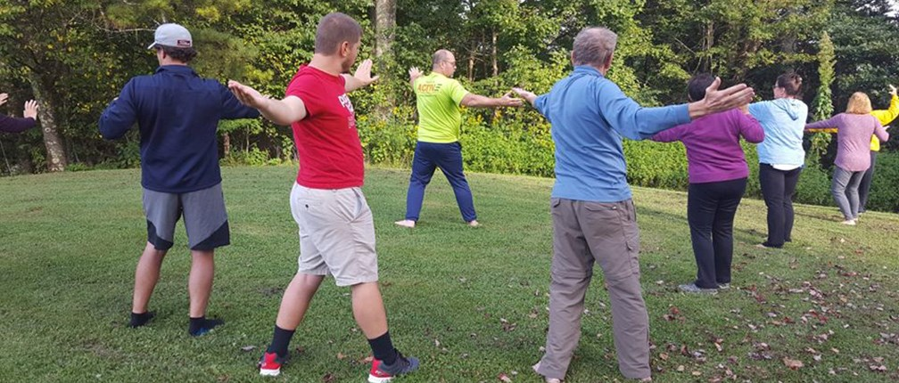 visitors attending a tai chi program
