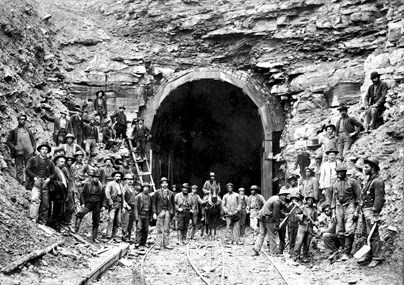 workers constructing a RR tunnel