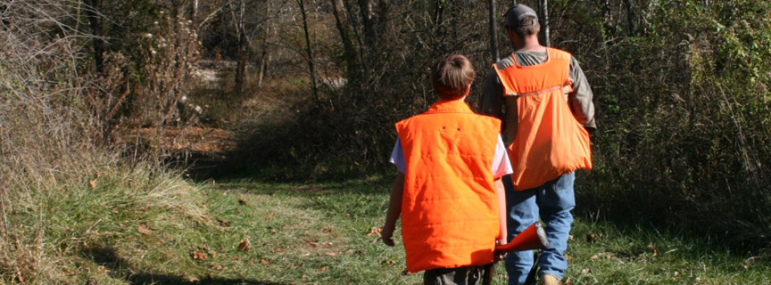 hunters in orange vests