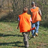 two hunters wearing blaze orange