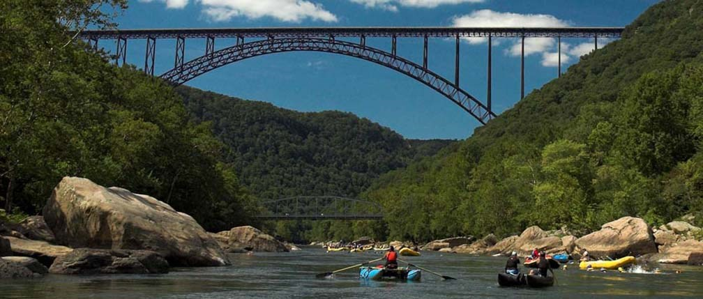 Rafters approach the New River Gorge Bridge