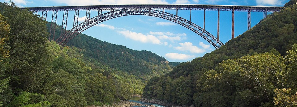 bridge spanning river and gorge