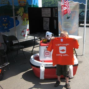 young visitor with a water safety tee shirt