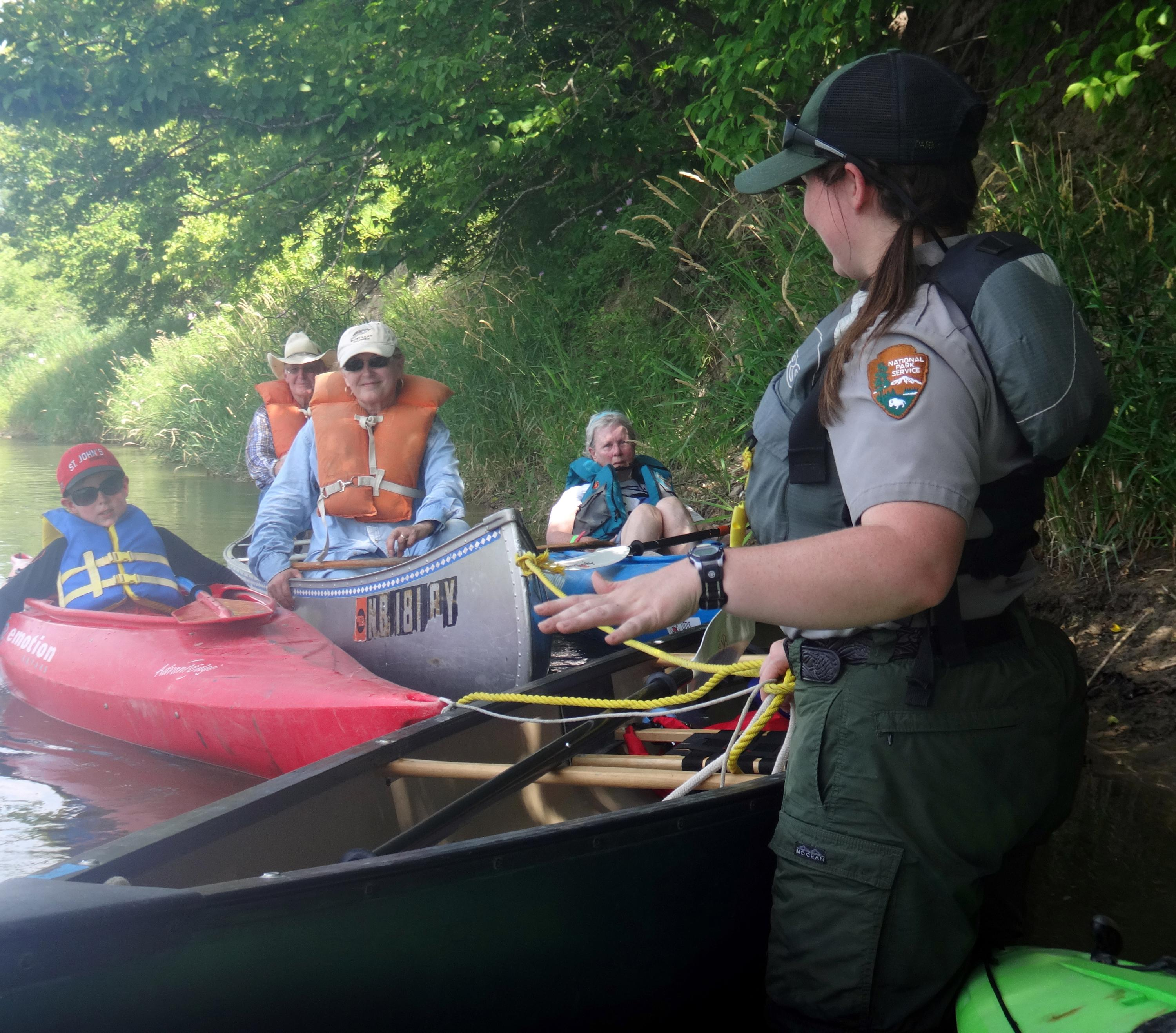 A park ranger points out special features about the Niobrara NSR to a group of paddlers.