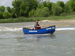 A canoer slips over a Class II- Ledge at Fritz's Island