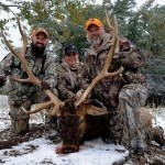 Three veterans with elk enjoying hunting on public lands.
