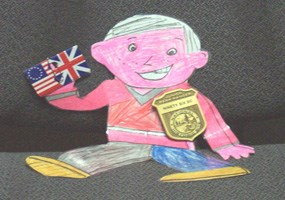 Flat Stanley with Jr Ranger badge and flags