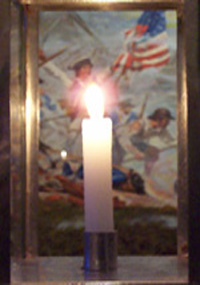Lit candle infront of historic battle painting