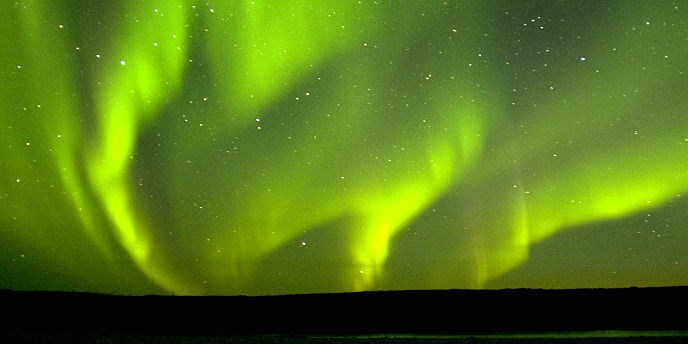 Brilliant green northern lights in the sky